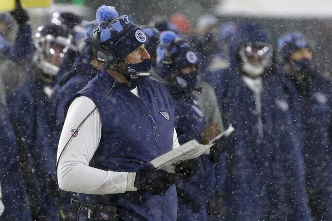 Tennessee Titans head coach Mike Vrabel watches during the first half of an NFL football game against the Green Bay Packers Sunday, Dec. 27, 2020, in Green Bay, Wis. (AP Photo/Mike Roemer)