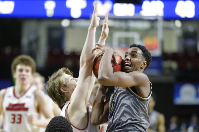 Montana State forward Abdul Mohamed is blocked while trying to shoot over Eastern Washington guard Jack Perry during an NCAA college basketball game for the championship of the Big Sky men's tournament in Boise, Idaho, Saturday, March 13, 2021. Eastern Washington won 65-55. (AP Photo/Otto Kitsinger)