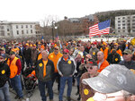 Gun rights supporters gather outside the Vermont Statehouse in Montpelier, Vt., on Saturday, March 31, 2018, to oppose gun restriction legislation passed by the Legislature. Protesters were giving away 1,200 30-round magazines. (AP Photo/Lisa Rathke)