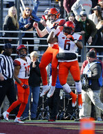 Syracuse quarterback Eric Dungey (2) celebrates with teammate Ravian Pierce (6) after scoring a touchdown during the first half of an NCAA college football game against Boston College, Saturday, Nov. 24, 2018, in Boston. (AP Photo/Mary Schwalm)