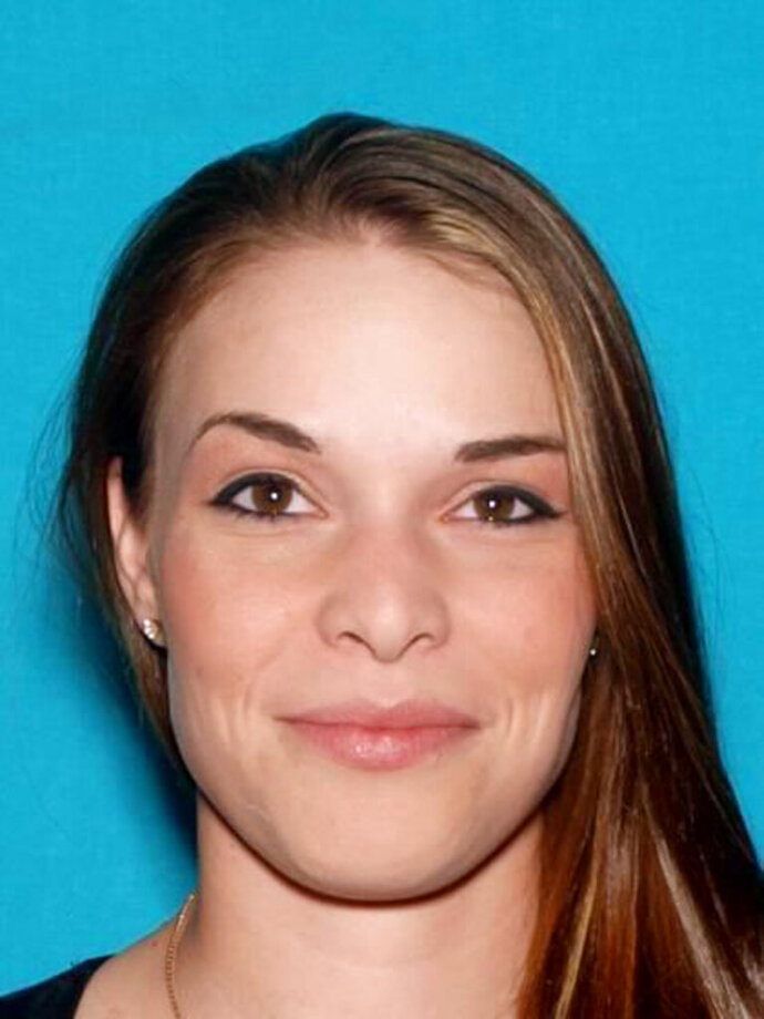 This undated photo provided by the Butte County Sheriff's Office shows 29 year-old Brenda Rose Asbury. An arrest warrant has been issued for Ashbury a woman authorities say embezzled more than $63,000 from a senior citizen who lost a home in a devastating Northern California wildfire. (Butte County Sheriff's Office via AP)