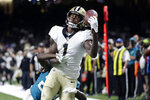 New Orleans Saints wide receiver Marquez Callaway (1) pulls in a one handed touchdown reception over Jacksonville Jaguars cornerback Shaquill Griffin in the first half of an NFL preseason football game in New Orleans, Monday, Aug. 23, 2021. (AP Photo/Derick Hingle)