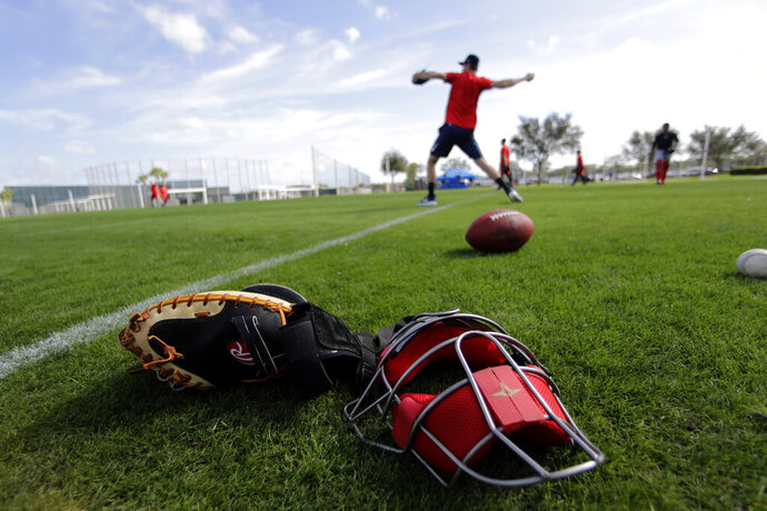 Boston Red Sox pitchers throw after reporting for spring training baseball Tuesday, Feb. 11, 2020, in Fort Myers, Fla. (AP Photo/John Bazemore)