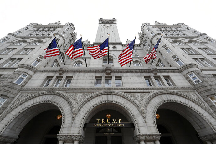 FILE - This Dec. 21, 2016 file photo shows the Trump International Hotel at 1100 Pennsylvania Avenue NW, in Washington. The Justice Department is asking a federal judge to let them file a legal appeal that could, for now, keep President Donald Trump's critics from gaining access to financial records related to his Washington hotel. (AP Photo/Alex Brandon, File)