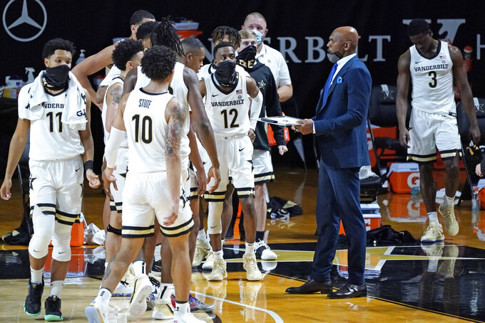Vanderbilt head coach Jerry Stackhouse talks with his players during a time out in the first half of an NCAA college basketball game against Valparaiso Friday, Nov. 27, 2020, in Nashville, Tenn. (AP Photo/Mark Humphrey)
