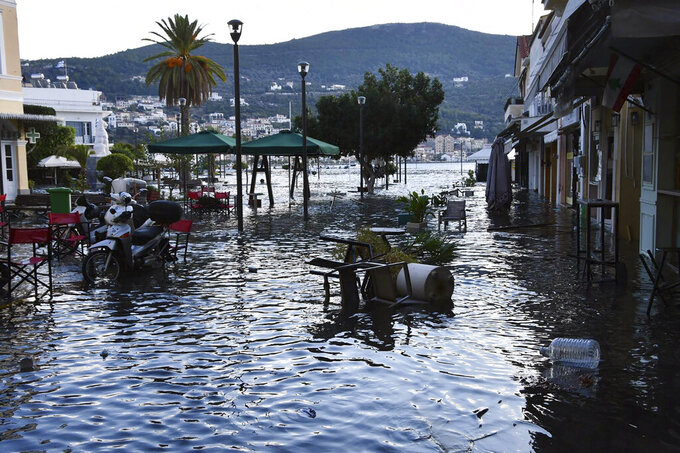 Seawater covers floods a square after an earthquake at the port of Vathi on the eastern Aegean island of Samos, Greece, Friday, Oct. 30, 2020. A strong earthquake struck in the Aegean Sea between the Turkish coast and the Greek island of Samos as the magnitude 6.6 earthquake was centered in the Aegean at a depth of 16.5 kilometers, or 10.3 miles.(AP Photo/Michael Svarnias)