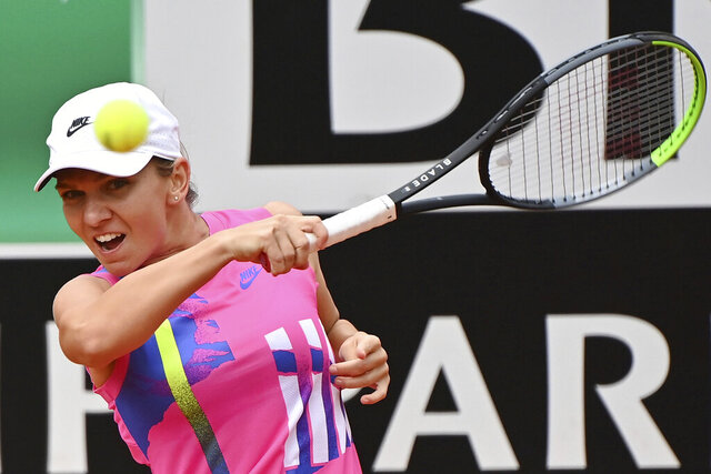 Romania's Simona Halep returns the ball to Czech Republic's Karolina Pliskova during their final match at the Italian Open tennis tournament, in Rome, Monday, Sept. 21, 2020. (Alfredo Falcone/LaPresse via AP)