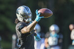 Carolina Panthers cornerback Jaycee Horn makes a catch during a drill at a joint practice with the Baltimore Ravens hosted by Carolina at the NFL football team's training camp in Spartanburg, S.C., Wednesday, Aug. 18, 2021. (AP Photo/Nell Redmond)