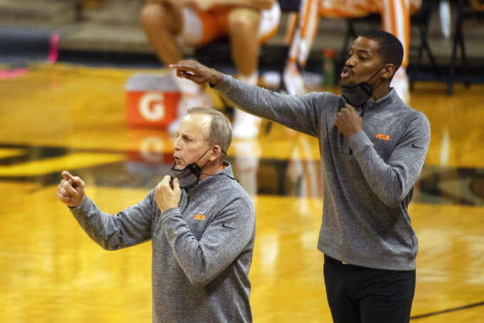 FILE - Tennessee head coach Rick Barnes, left, and assistant coach Kim English, right, position their players during the first half of an NCAA college basketball game against Missouri in Columbia, Mo., in this Wednesday, Dec. 30, 2020, file photo. Former NBA player and college assistant Kim English was hired to coach George Mason's men's basketball team Tuesday, March 23, 2021, exactly a week after the school fired Dave Paulsen.(AP Photo/L.G. Patterson, File)