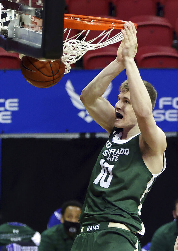 Colorado State forward James Moors (10) dunks during the second half of an NCAA college basketball game against Utah State in the semifinal round of the Mountain West Conference men's tournament Friday, March 12, 2021, in Las Vegas. (AP Photo/Isaac Brekken)
