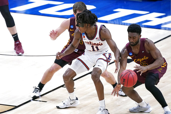 Loyola of Chicago's Keith Clemons (5) steals the ball from Illinois' Ayo Dosunmu (11) during the first half of a college basketball game in the second round of the NCAA tournament at Bankers Life Fieldhouse in Indianapolis Sunday, March 21, 2021. (AP Photo/Mark Humphrey)
