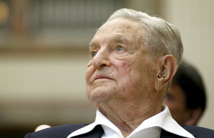 FILE - In this June 21, 2019 file photo, George Soros, Founder and Chairman of the Open Society Foundations, looks before the Joseph A. Schumpeter award ceremony in Vienna, Austria.  Soros is playing a key part in conservative efforts to defend President Donald Trump ahead of a looming impeachment vote. It's hardly a new role for Soros, whose multi-billion-dollar philanthropic network and investment in Democratic politics has made him a long-running enemy for the far right. (AP Photo/Ronald Zak, File)
