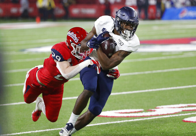 Nevada wide receiver Romeo Doubs tries to get away from Fresno State linebacker Justin Rice during the first half of an NCAA college football game in Fresno, Calif., Saturday, Nov. 23, 2019. (AP Photo/Gary Kazanjian)