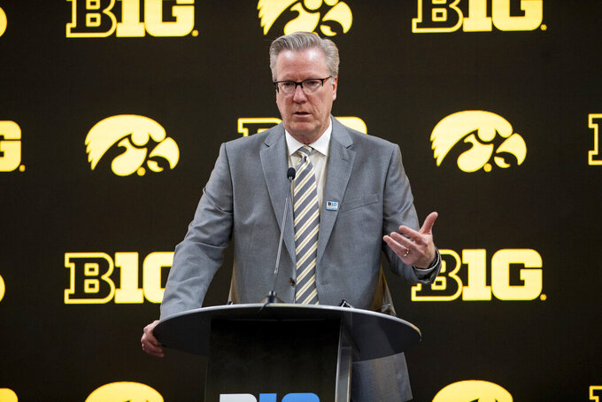 FILE - Iowa men's head coach Fran McCaffery addresses the media during the first day of the Big Ten NCAA college basketball media days, Thursday, Oct. 7, 2021, in Indianapolis. McCaffery goes into this season without two players who combined to average nearly 40 points and 15 rebounds per game last season. Both were NBA draft picks, one was national player of the year. Yes, Iowa's 12th-year coach has his work cut out for him. (AP Photo/Doug McSchooler)