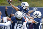 Utah State wide receiver Jordan Nathan (16) celebrates with teammates DJ Nelson (12) and Taylor Compton (17) after catching a 24-yard touchdown pass against UNLV during an NCAA college football game Saturday, Oct. 13, 2018, in Logan, Utah. (Eli Lucero/The Herald Journal via AP)