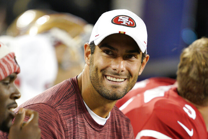 San Francisco 49ers quarterback Jimmy Garoppolo smiles on the sideline during the second half of the team's NFL preseason football game against the Los Angeles Chargers in Santa Clara, Calif., Thursday, Aug. 29, 2019. (AP Photo/Tony Avelar)