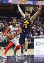 Detroit Pistons' Derrick Rose (25) drives against Cleveland Cavaliers' Matthew Dellavedova (18) in the second half of an NBA basketball game, Tuesday, Jan. 7, 2020, in Cleveland. Detroit won 115-113.(AP Photo/Tony Dejak)
