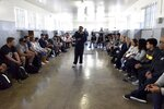 Members of the University of Michigan American Football Team listen to former prisoner turned guide, Ntando Mbatha, during their visit to Robben Island in Cape Town, South Africa, Sunday, May 5, 2019. The team visited the former prison Island where former President Nelson Mandela spent time. (AP Photo/Nasief Manie)