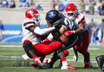 Air Force running back Christian Mallard, center, is stopped after a short gain by Stony Brook defensive lineman Casey Williams, left, and linebacker Deyshaun Tucker in the second half of an NCAA college football game Saturday, Sept. 1, 2018, at Air Force Academy, Colo. Air Force won 38-0. (AP Photo/David Zalubowski)