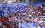 Supporters from North Korea are reflected on the glass at Gangneung Hockey Centre during the third period of the preliminary round of the men's hockey game between the Czech Republic and South Korea at the 2018 Winter Olympics in Gangneung, South Korea, Thursday, Feb. 15, 2018. (AP Photo/Frank Franklin II)