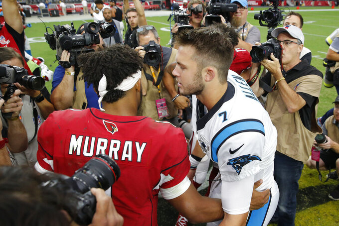 Arizona Cardinals quarterback Kyler Murray (1) greets Carolina Panthers quarterback Kyle Allen (7) after an NFL football game, Sunday, Sept. 22, 2019, in Glendale, Ariz. The Panthers won 38-20. (AP Photo/Rick Scuteri)