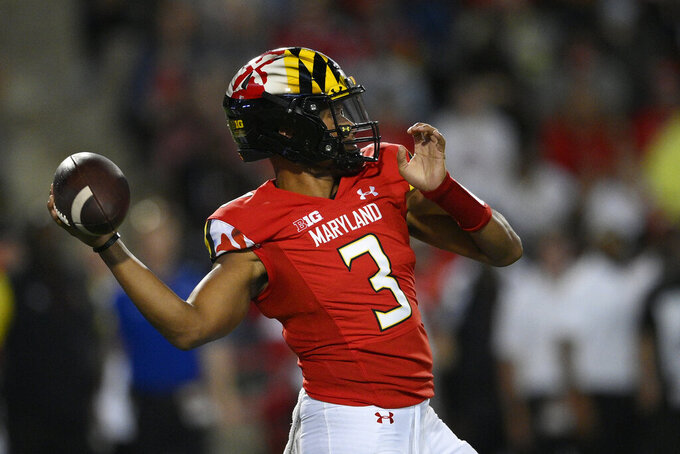 Maryland quarterback Taulia Tagovailoa (3) passes during the first half of an NCAA college football game against Howard, Saturday, Sept. 11, 2021, in College Park, Md. (AP Photo/Nick Wass)