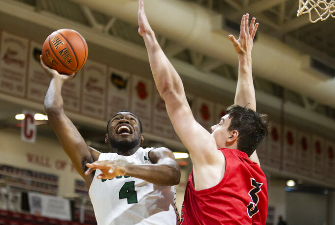 Chicago State forward Ke'Sean Davis (4) takes a shot over Jacksonville State center Maros Zeliznak (3) in the first half of an NCAA college basketball game at the Emerald Coast Classic in Niceville, Fla., Friday, Nov. 29, 2019. (AP Photo/Mark Wallheiser)