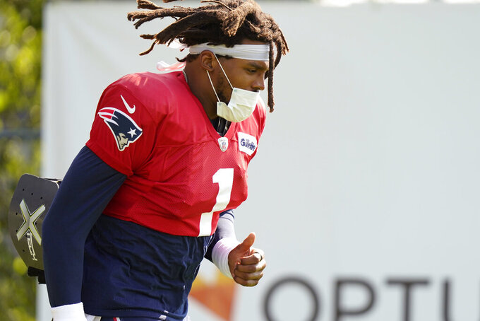 New England Patriots quarterback Cam Newton steps on the field at the start of a joint NFL football practice with the New York Giants, Thursday, Aug. 26, 2021, in Foxborough, Mass. (AP Photo/Steven Senne)