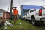 Standing in front of his house covered in a blue tarp from Hurricane Laura damage, Joshua Espree, 30, plans on staying in Lake Charles, La., and helping his family  as Hurricane Delta approaches the area  on Friday, Oct. 9, 2020.  Delta is expected to make landfall late Friday. (Chris Granger /The Advocate via AP)