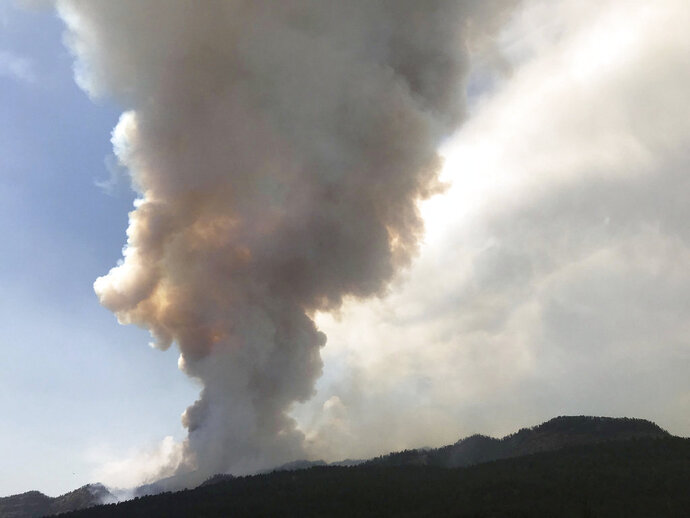A gigantic plume of smoke rises as the 416 Fire burns near Durango, Colo., Wednesday, June 13, 2018. (Jerry McBride/The Durango Herald via AP)