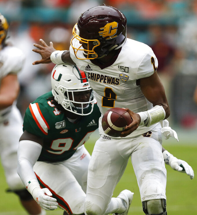 Miami defensive lineman Trevon Hill (94) sacks Central Michigan quarterback David Moore (2) during the first half of an NCAA college football game, Saturday, Sept. 21, 2019, in Miami Gardens, Fla. (AP Photo/Brynn Anderson)