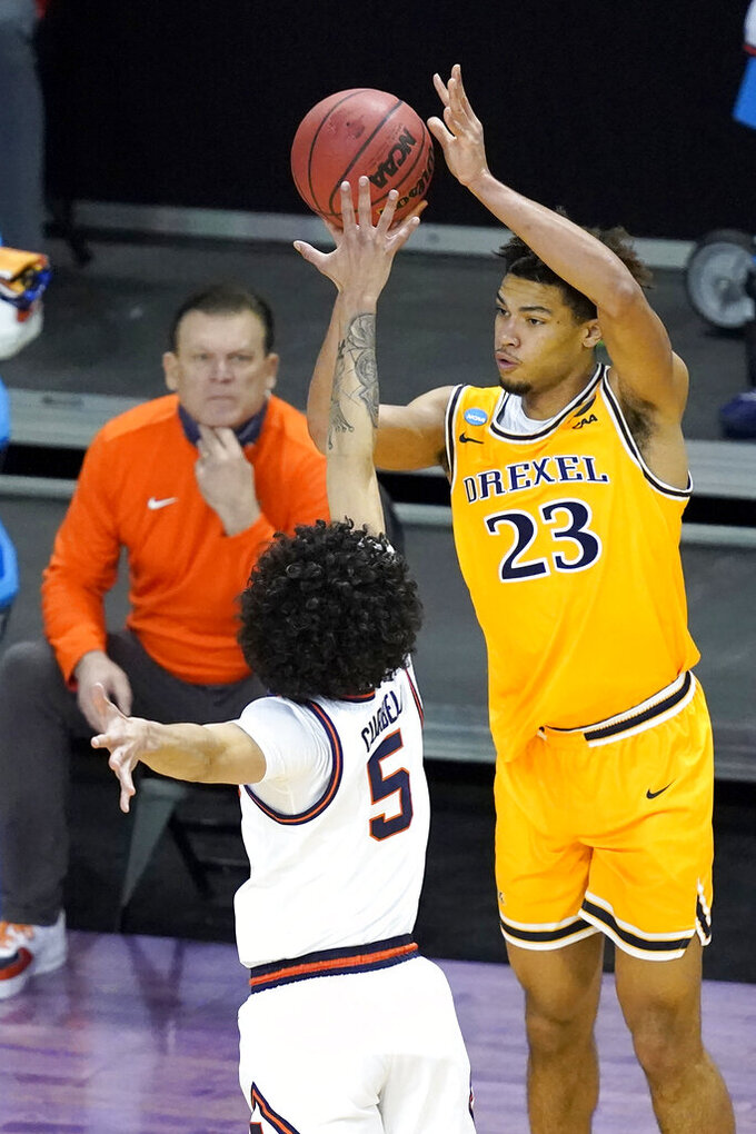 Drexel's T.J. Bickerstaff (23) shoots over Illinois 's Andre Curbelo (5) was Illinois head coach Brad Underwood watches, during the first half of a first round NCAA college basketball tournament game Friday, March 19, 2021, at the Indiana Farmers Coliseum in Indianapolis .(AP Photo/Charles Rex Arbogast)