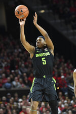 Michigan State guard Cassius Winston (5) shoots a three-point basket during the first half of an NCAA college basketball game against the Maryland, Saturday, Feb. 29, 2020, in College Park, Md. (AP Photo/Terrance Williams)