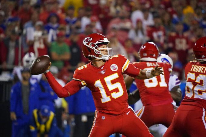 Kansas City Chiefs quarterback Patrick Mahomes throws during the first half of an NFL football game against the Buffalo Bills Sunday, Oct. 10, 2021, in Kansas City, Mo. (AP Photo/Ed Zurga)