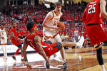 Texas' Will Baker (50) charges through Texas Tech's Terrence Shannon Jr. (1) during the first half of an NCAA college basketball game Saturday, Feb. 29, 2020, in Lubbock, Texas. (AP Photo/Brad Tollefson)