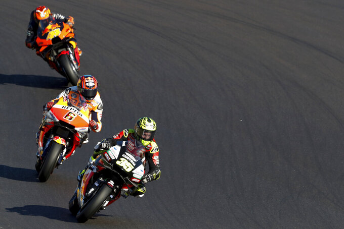 MotoGP rider Cal Crutchlow of Great Britain steers his motorcycle ahead of Stefan Bradl of Germany and Pol Espargaro of Spain during the MotoGP race of the Portuguese Motorcycle Grand Prix, the last race of the season, at the Algarve International circuit near Portimao, Portugal, Sunday, Nov. 22, 2020. (AP Photo/Armando Franca)