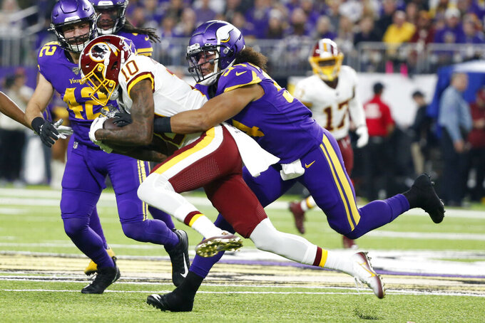 Washington Redskins wide receiver Paul Richardson (10) is tackled by Minnesota Vikings middle linebacker Eric Kendricks (54) after catching a pass during the first half of an NFL football game, Thursday, Oct. 24, 2019, in Minneapolis. (AP Photo/Bruce Kluckhohn)