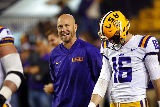 File-This Nov. 25, 2017, file photo shows then LSU offensive coordinator Matt Canada walking on the field before an NCAA college football game against Texas A&M in Baton Rouge, La.  Maryland offensive coordinator Canada is the interim coach. The 46-year-old came to Maryland after coaching at seven schools over the past nine years, including a one-and-done stint at Louisiana State in 2017. Now, without a shred of head coaching experience, Canada is in control of a shaken Big Ten team in disarray. (AP Photo/Gerald Herbert, File)