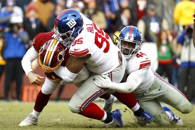 New York Giants defensive end B.J. Hill (95) and linebacker Markus Golden (44) sack Washington Redskins quarterback Case Keenum during the second half of an NFL football game, Sunday, Dec. 22, 2019, in Landover, Md. (AP Photo/Patrick Semansky)