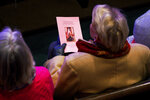 A woman holds the program for the remembrance service for six-year-old Faye Swetlik at Trinity Baptist Church in Cayce, S.C., Friday, Feb. 21, 2020. (Josh Morgan/The Greenville News via AP)