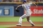 Texas Rangers starting pitcher Jesse Chavez throws against the Tampa Bay Rays during the first inning of a baseball game Sunday, June 30, 2019, in St. Petersburg, Fla. (AP Photo/Mike Carlson)
