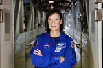 In this Tuesday, June 25, 2019 file photo made available by NASA, astronaut Megan McArthur poses for a portrait at the Kennedy Space Center in Florida. The space station astronaut is celebrating her 50th birthday with the coolest present ever _ a supply ship bearing ice cream and other treats. SpaceX's latest cargo delivery showed up Monday, Aug. 30, 2021 at the International Space Station after a day in transit. Overseeing the automated docking was NASA astronaut Megan McArthur. (Joel Kowsky/NASA via AP)