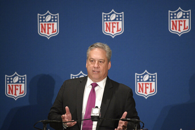 FILE - In this March 26, 2018, file photo, Al Riveron, NFL senior vice president of officiating, answers a question from a reporter during a news conference announcing rules changes at the NFL owners meetings in Orlando, Fla. Riveron, a Cuban who became the league's first Hispanic referee, is retiring Friday, Aug. 6, 2021. Riveron worked as an on-field official for nine years and became a member of the NFL's officiating staff in 2013.  (Phelan M. Ebenhack/AP Images for NFL, File)