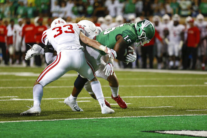 North Texas running back Tre Siggers (15) scores a touchdown during the second half of an NCAA college game against the Houston on Saturday, Sept. 28, 2019, in Denton, Texas.  (Kara Dry/The Denton Record-Chronicle via AP)
