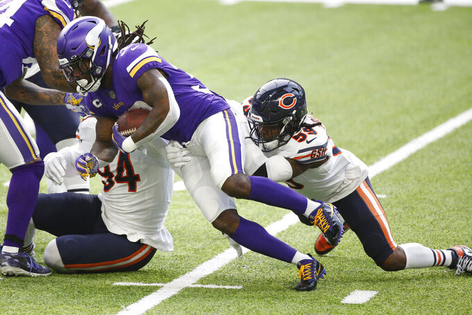 Minnesota Vikings running back Dalvin Cook is tackled by Chicago Bears linebacker Danny Trevathan, right, during the first half of an NFL football game, Sunday, Dec. 20, 2020, in Minneapolis. (AP Photo/Bruce Kluckhohn)