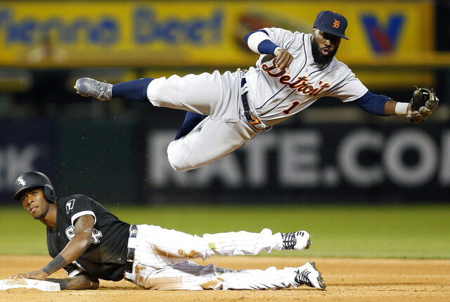 FILE - Detroit Tigers second baseman Josh Harrison (1) falls after throwing to first base while Chicago White Sox's Tim Anderson, bottom, is out on a fielder's choice during a baseball game in a Friday, April 26, 2019 file photo, in Chicago. Utility player Josh Harrison has signed a one-year contract with the Washington Nationals. The Nationals added the 33-year-old Harrison to their 30-man active roster Monday, July 27, 2020. (AP Photo/Nuccio DiNuzzo, File)
