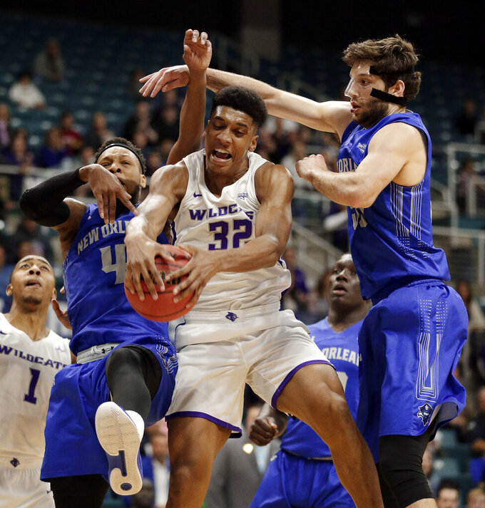 Abilene Christian forward Joe Pleasant (32) pulls in a rebound between New Orleans guard Bryson Robinson (4) and forward Scott Plaisance Jr., right, during the first half of an NCAA college basketball game for the Southland Conference men's tournament title Saturday, March 16, 2019, in Katy, Texas. (AP Photo/Michael Wyke)