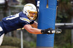 Los Angeles Chargers defensive end Joey Bosa runs a drill during an NFL football training camp in Costa Mesa, Calif., Monday, July 29, 2019. (AP Photo/Kyusung Gong)
