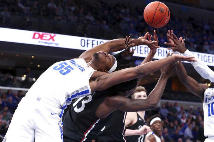 Memphis' forward Precious Achiuwa (55) goes all in for a rebound in the second half of an NCAA college basketball game against Cincinnati Thursday, Jan. 16, 2020, in Memphis, Tenn. (AP Photo/Karen Pulfer Focht)