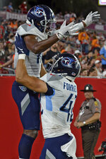 Tennessee Titans wide receiver Dez Fitzpatrick (10) celebrates with tight end Miller Forristall (42) after Fitpatrick caught a 23-yard touchdown reception against the Tampa Bay Buccaneers during the second half of an NFL preseason football game Saturday, Aug. 21, 2021, in Tampa, Fla. (AP Photo/Jason Behnken)